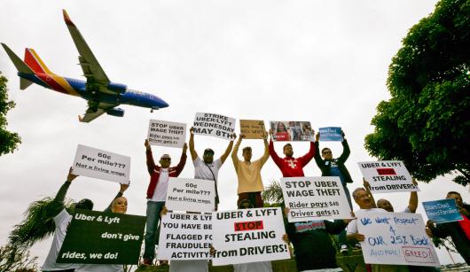 '저임금·장시간 노동 개선' 우버·리프트 '파업 들불'